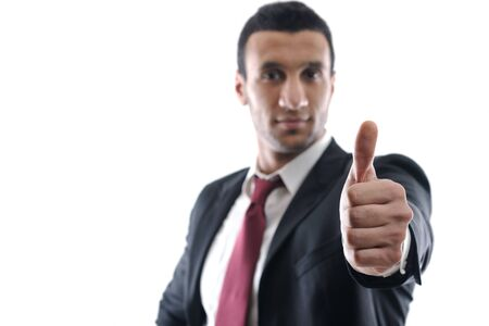 Portrait of a young business man showing thumb up concept Stock Photo - 12303817