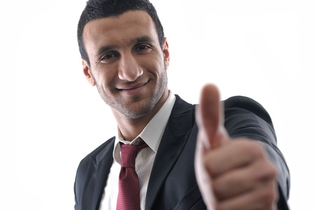Portrait of a young business man showing thumb up concept Stock Photo - 12303909