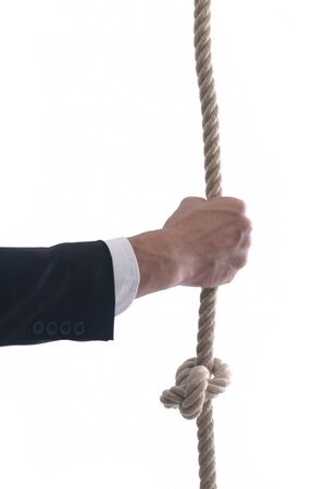 Business man pulling and bond tied with rope concept isolated on white background in studio Stock Photo - 12303788