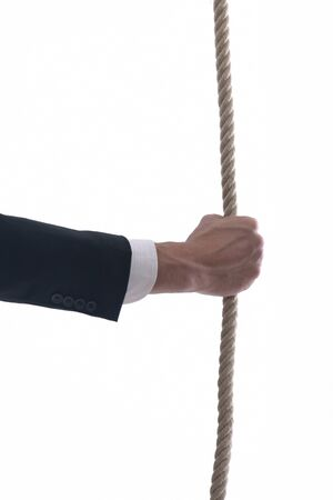 Business man pulling and bond tied with rope concept isolated on white background in studio Stock Photo - 12303784
