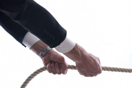 Business man pulling and bond tied with rope concept isolated on white background in studio Stock Photo - 12303810