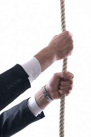 Business man pulling and bond tied with rope concept isolated on white background in studio Stock Photo - 12303804