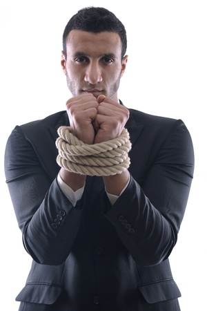 Business man pulling and bond tied with rope concept isolated on white background in studio photo