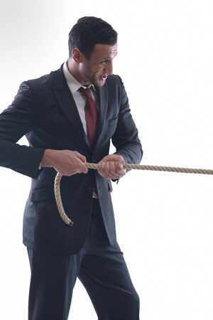 Business man pulling and bond tied with rope  concept  isolated on white background in studio Stock Photo - 12303854