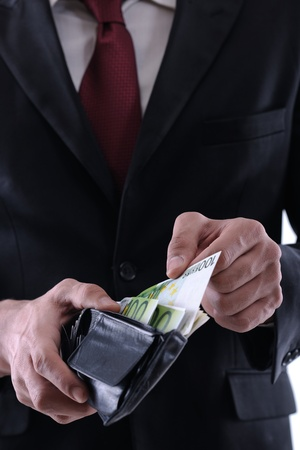 Business man holding money Stock Photo - 12303886