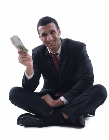 Business man holding money Stock Photo - 12303837