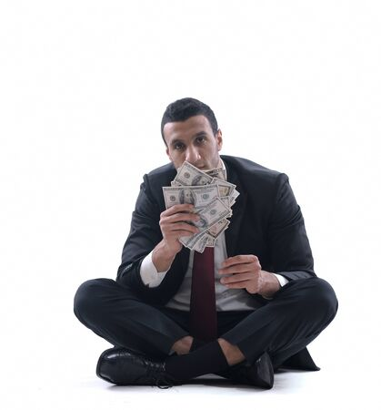 Business man holding money Stock Photo - 12303786
