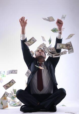 Business man holding money Stock Photo - 12303874