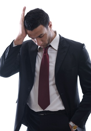 Portrait of a young business man looking depressed from work isolated over white background in studio Stock Photo - 12303821