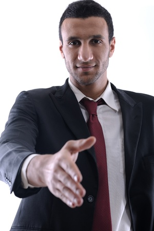 Confident business man giving you a hand shake on white background representing concept of success and cooperation photo