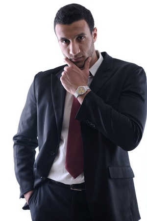 Portrait of a young business man looking depressed from work isolated over white background in studio Stock Photo - 12303882