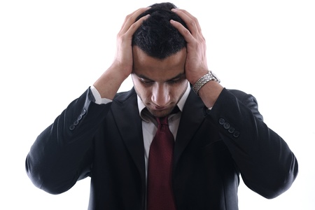 Portrait of a young business man looking depressed from work isolated over white background in studio Stock Photo - 12303946