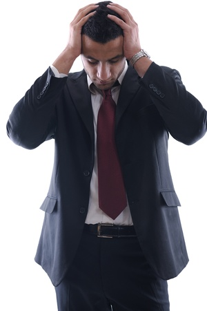 Portrait of a young business man looking depressed from work isolated over white background in studio Stock Photo - 12303913