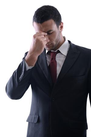 male headache: Retrato de un joven hombre de negocios con aspecto deprimido del trabajo aislado sobre fondo blanco en estudio Foto de archivo
