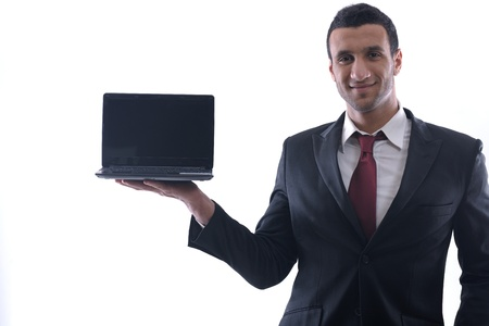 Smiling business man hold and work on mini laptop comuter   Isolated on white background in studio Stock Photo - 12303839
