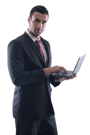 Smiling business man hold and work on mini laptop comuter   Isolated on white background in studio Stock Photo - 12303851