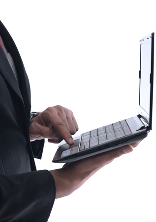 Smiling business man hold and work on mini laptop comuter   Isolated on white background in studio Stock Photo - 12303800