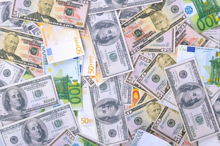 Business money background with us dollars and european euro photo