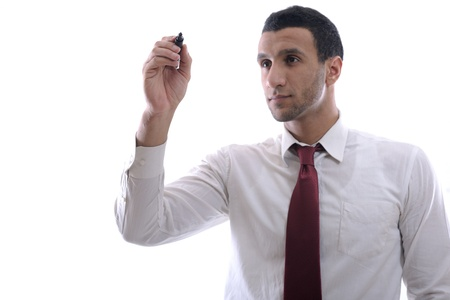 hombre escribiendo: Hombre de negocios dibujar con marcador en copia espacio vac�o aislado en blanco en el estudio Foto de archivo