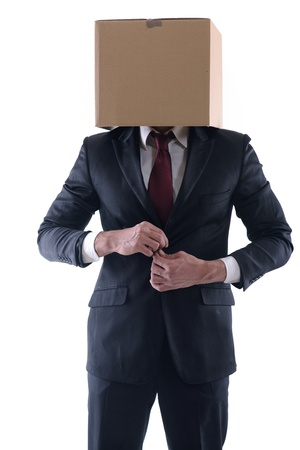 Anonymous business man with a cardboard box on his head concealing his identity photo