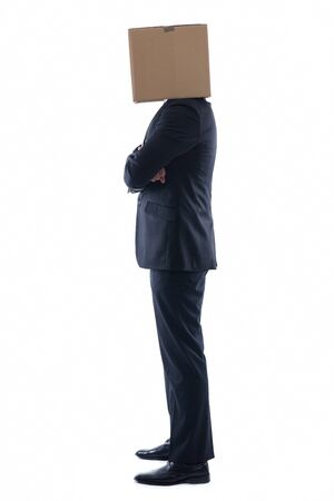 Anonymous business man with a cardboard box on his head concealing his identity Stock Photo - 12303813