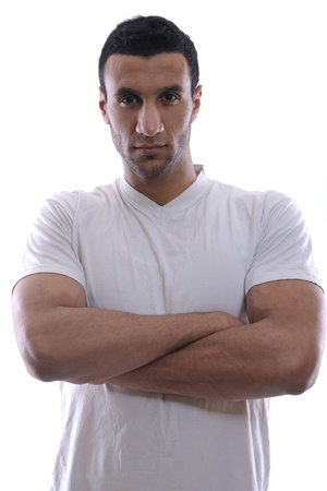 arab people: Portrait of relaxed young man dressed in white shirt and jeans isolated over white background in studio