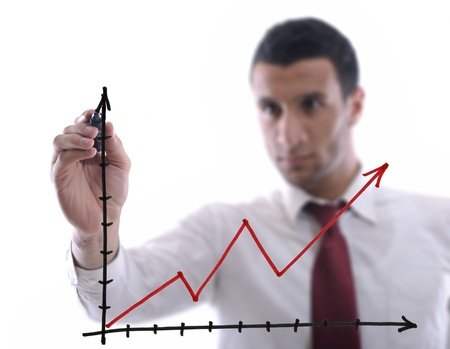 writing on glass: business man draw success line chart   isolated on white background  in studio