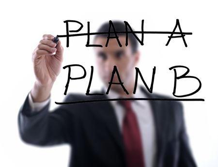 studio b: business man draw business solutions and plan b concept  with marker on glass  isolated on white background  in studio