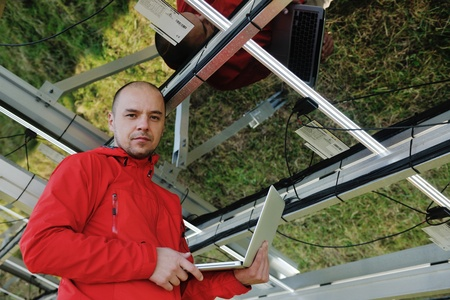 business man  engineer using laptop at solar panels plant eco energy field  in background Stock Photo - 12571012