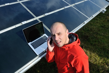 business man  engineer using laptop at solar panels plant eco energy field  in background Stock Photo - 12570996