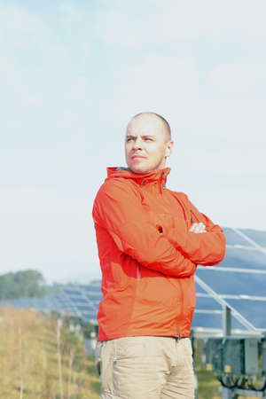 vision repair: Male engineer at work place, solar panels plant industy in background Editorial