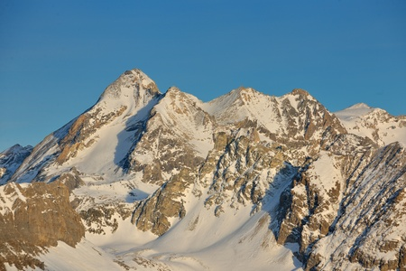 High mountains under fresh snow in the winter  season photo