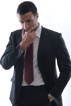 confusing: Portrait of a young business man looking depressed from work isolated over white background in studio
