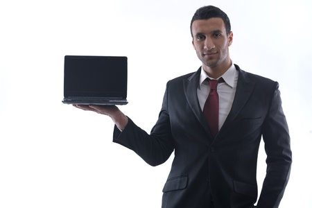Smiling business man hold and work on mini laptop comuter   Isolated on white background in studio photo