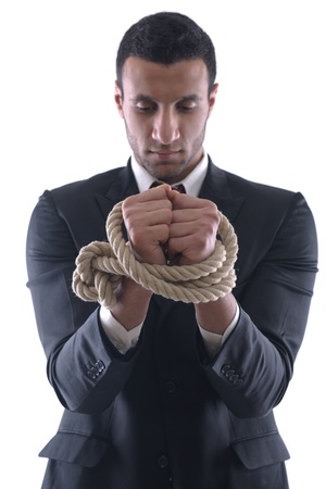 Business man pulling and bond tied with rope  concept  isolated on white background in studio Stock Photo - 12565475