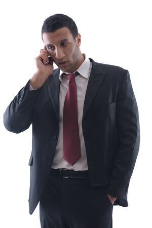 Portrait of a business man talk with cell mobile  phone isolated on white background. Studio shot communication concept photo