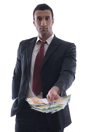 hombre cayendose: Retrato de un hombre de negocios y celebración atrapar la caída de las cuentas de dinero, aislados en el fondo blanco en estudio