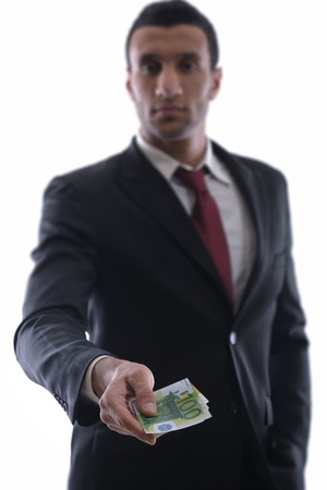Portrait of a business man holding and catch falling money bills, isolated on white background in studio photo