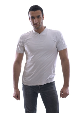 portrait of relaxed young man dressed in white shirt and jeans isolated over white background in studio Stock Photo - 12565521