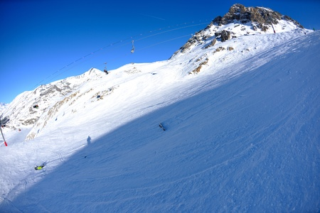 skiing on fresh snow at winter season at beautiful sunny day photo