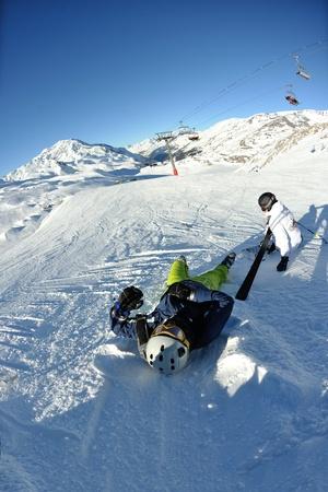 skiing on fresh snow at winter season at beautiful sunny day photo