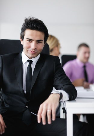 Confident young business man attending a meeting with his colleagues Stock Photo - 12565252