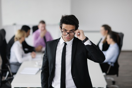 Confident young business man attending a meeting with his colleagues Stock Photo - 12565244