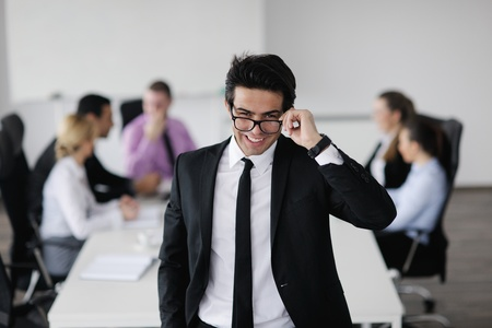 Confident young business man attending a meeting with his colleagues Stock Photo - 12565250
