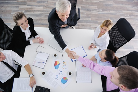 business people  team  at a meeting in a light and modern office environment. Stock Photo - 12565168