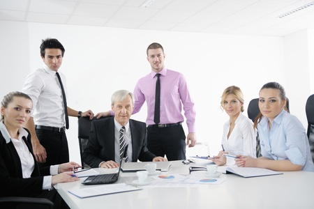 business people  team  at a meeting in a light and modern office environment. Stock Photo - 12565212