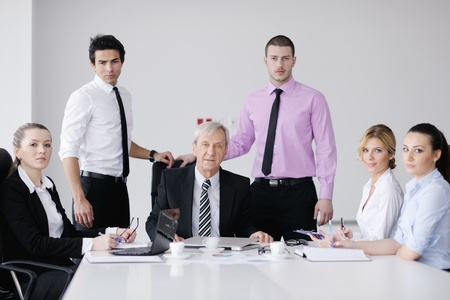 business people  team  at a meeting in a light and modern office environment. Stock Photo - 12565201