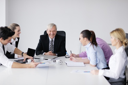 business people  team  at a meeting in a light and modern office environment. Stock Photo - 12565207