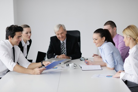 business people  team  at a meeting in a light and modern office environment. photo