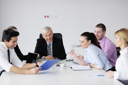 business people  team  at a meeting in a light and modern office environment. Stock Photo - 12565169